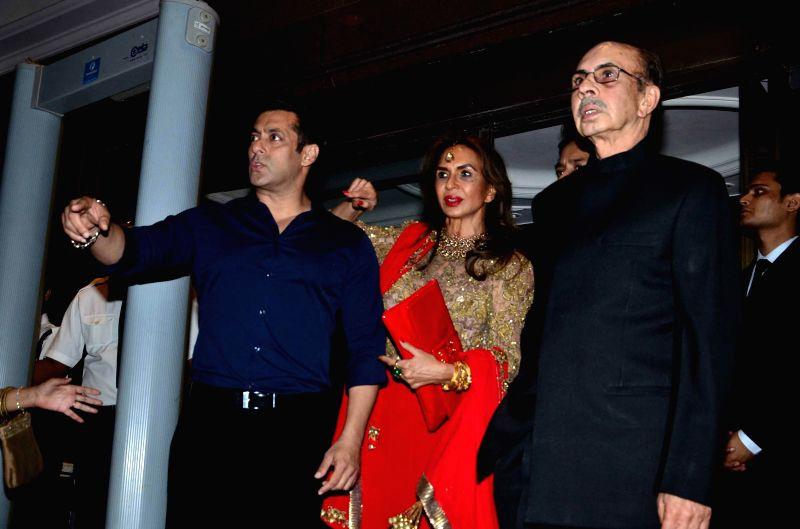 Actor Salman Khan, Industralist Adi Godrej along with his wife Parmeshwar Godrej during Arpita Khan's marriage reception in Mumbai, on November 21, 2014. - Salman Khan