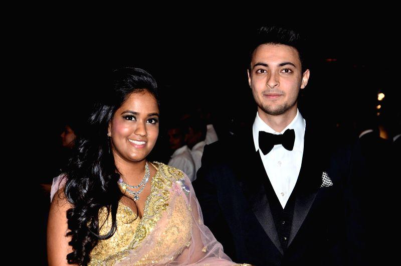 Actor Salman Khan's sister Arpita Khan along with her husband Aayush Sharma during her marriage reception in Mumbai on November 21, 2014. - Salman Khan and Aayush Sharma