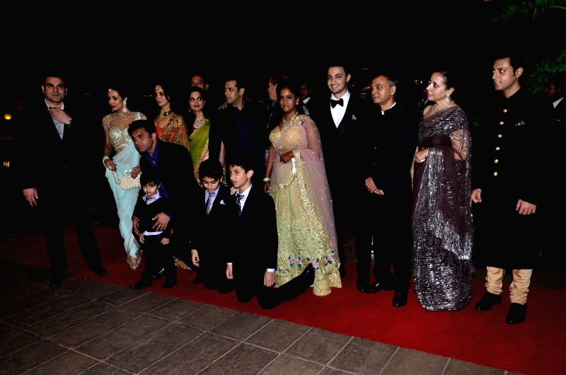 Actor Salman Khan's sister Arpita Khan along with her husband Aayush Sharma and her family members during her marriage reception on November 21, 2014. - Salman Khan and Aayush Sharma