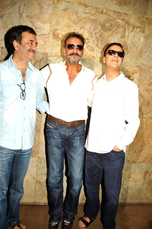 Actor Sanjay Dutt along with Filmmakers Vidhu Vinod Chopra and Raju Hirani during the special screening film PK, in Mumbai, on December 25, 2014. - Sanjay Dutt, Vidhu Vinod Chopra and Raju Hirani