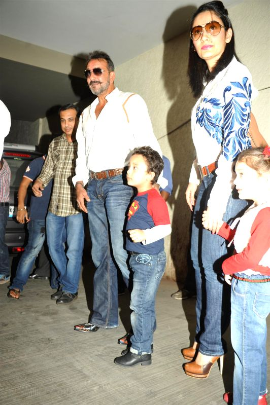 Actor Sanjay Dutt along with his wife Manyata and children Iqra and Shahraan during the special screening film PK, in Mumbai, on December 25, 2014. - Sanjay Dutt