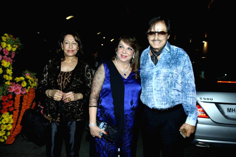 Actor Sanjay Khan along with his wife Zarine Khan during the special screening of Hollywood film The Second Best Exotic Marigold Hotel in Mumbai, on March 13, 2015. - Sanjay Khan and Zarine Khan