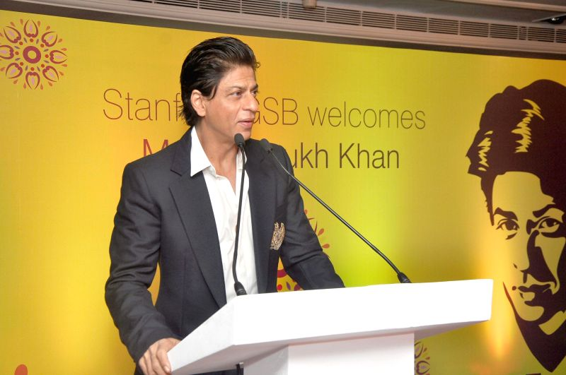 Actor Shah Rukh Khan addresses the students of the Stanford University during a programme in Mumbai on Dec 18, 2014. - Shah Rukh Khan