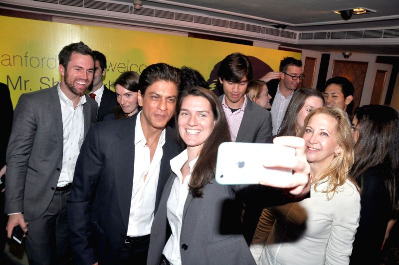 Actor Shah Rukh Khan with the students of the Stanford University during a programme in Mumbai on Dec 18, 2014. - Shah Rukh Khan
