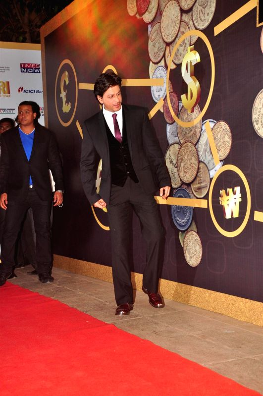 Actor Shahrukh Khan at the NRI of the year awards, in Mumbai on April 10, 2015. - Shahrukh Khan