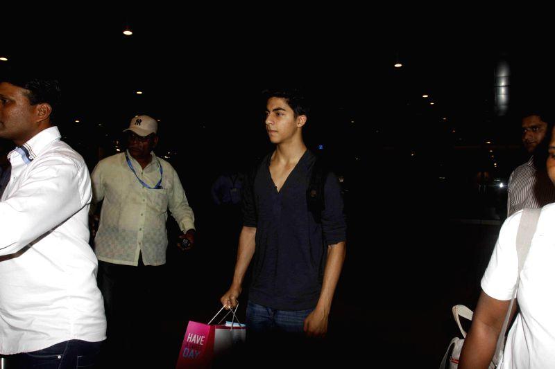 Actor Shahrukh Khan`s son Aryan spotted at Mumbai airport in Mumbai on Jan 4, 2015.