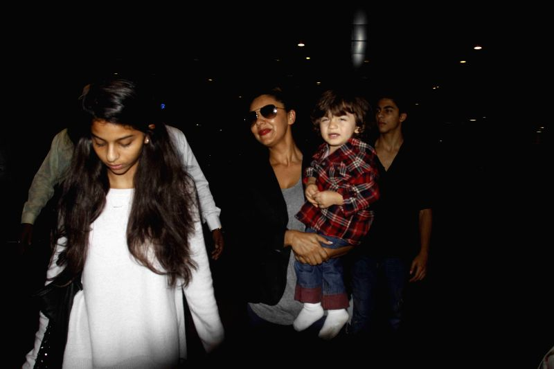 Actor Shahrukh Khan`s wife Gauri Khan with son AbRam Khan and daughter Suhana spotted at Mumbai airport in Mumbai on Jan 4, 2015.