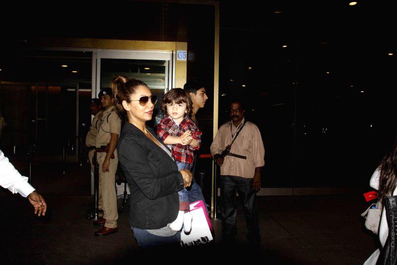 Actor Shahrukh Khan`s wife Gauri Khan with son AbRam Khan spotted at Mumbai airport in Mumbai on Jan 4, 2015.