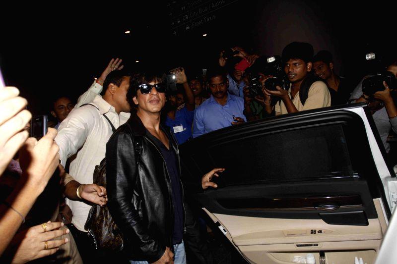 Actor Shahrukh Khan spotted at Mumbai airport in Mumbai on Jan 4, 2015.