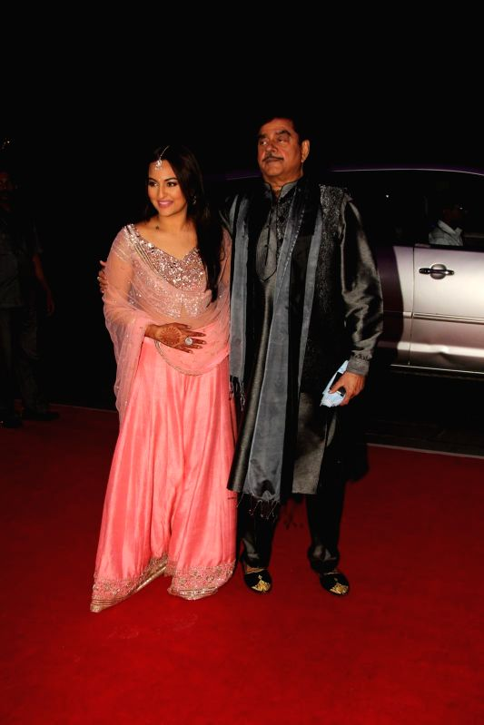 Actor Shatrugan Sinha along with his daughter Sonakshi Sinha during his son Kush wedding reception in Mumbai, on Jan. 19, 2015. - Shatrugan Sinha and Sonakshi Sinha