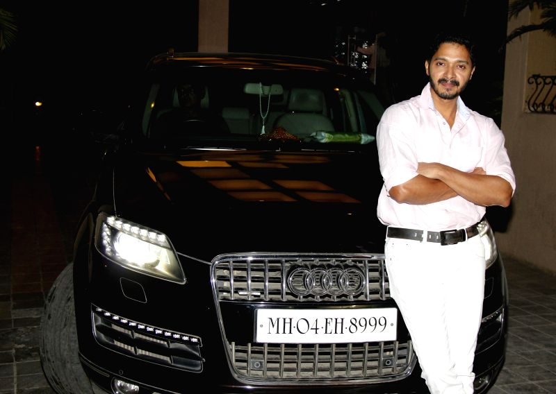 Actor Shreyas Talpade poses with his brand new Audi Q7 car at Juhu in Mumbai on Dec. 27, 2014.