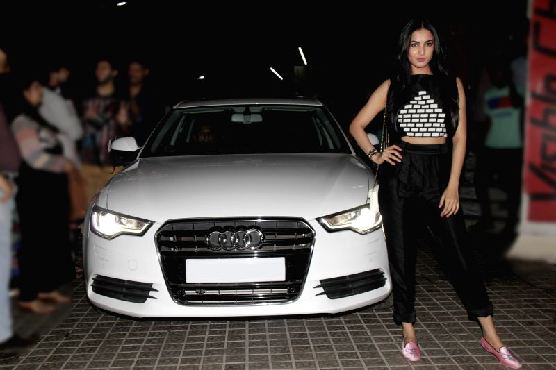 Actor Sonal Chauhan snapped posing with her new Audi A4 car at PVR Cinemas in Mumbai, on March 19, 2015.