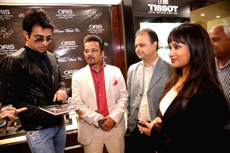 Actor Sonu Sood, Sanjay Mishra, Hemal Kharod from Tradepost & Priyanka Saha during the unveiling of ORIS Pro Pilot Altimeter in Rama Watch Boutique, in Mumbai on Dec. 12, 2014. - Sanjay Mishra