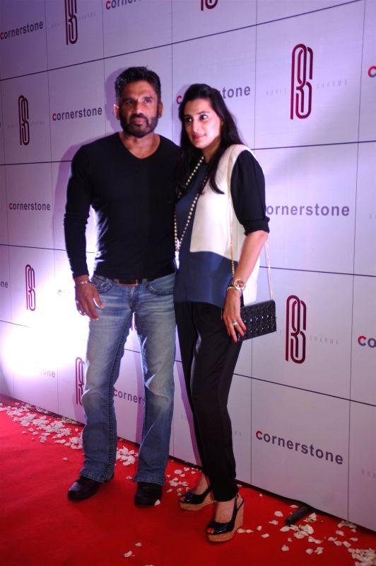 Actor Sunil Shetty along with his wife Mana Shetty arrives for felicitation ceremony of cricketer Rohit Sharma who hit a world-record double century in Mumbai, on November 20, 2014. - Sunil Shetty and Mana Shetty