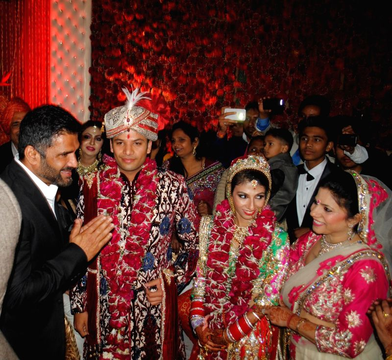 Actor Sunil Shetty, Atin and Lalita snapped at producer Krishna Choudhary's daughter's wedding in Mumbai on 12th February 2013 . - Sunil Shetty