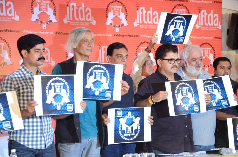 :Mumbai: Actor Sushant Singh, filmmaker Sudhir Mishra, Producer B. P. Singh and filmmaker Ashoke Pandit at a press conference organised by Indian Film and Television Directors' Association ...