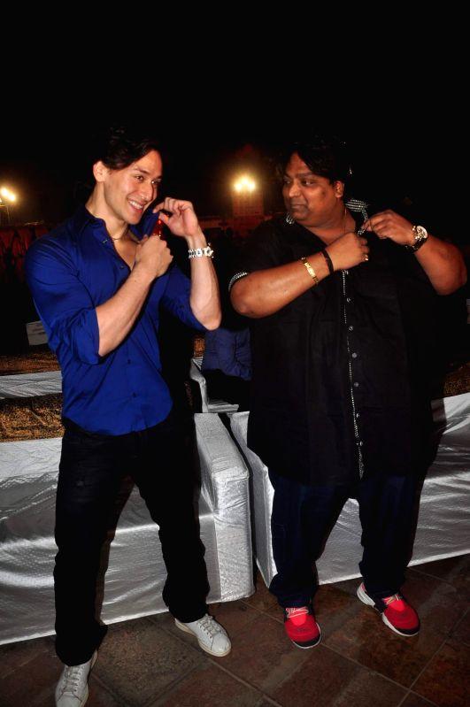 Actor Tiger Shroff and choreographer Ganesh Acharya during the success bash of film Hey Bro music in Mumbai on Feb 22, 2015. - Tiger Shroff