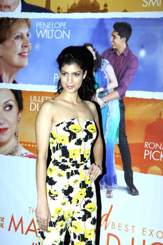 Actor Tina Desai during the special screening of Hollywood film The Second Best Exotic Marigold Hotel in Mumbai, on March 13, 2015. - Tina Desai