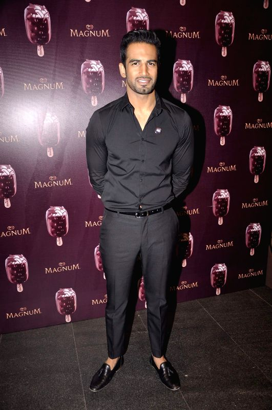 Actor Upen Patel during the launch of a new Choco Cappuccino flavour of HUL`s Magnum Icecream in Mumbai on Feb 22, 2015. - Upen Patel