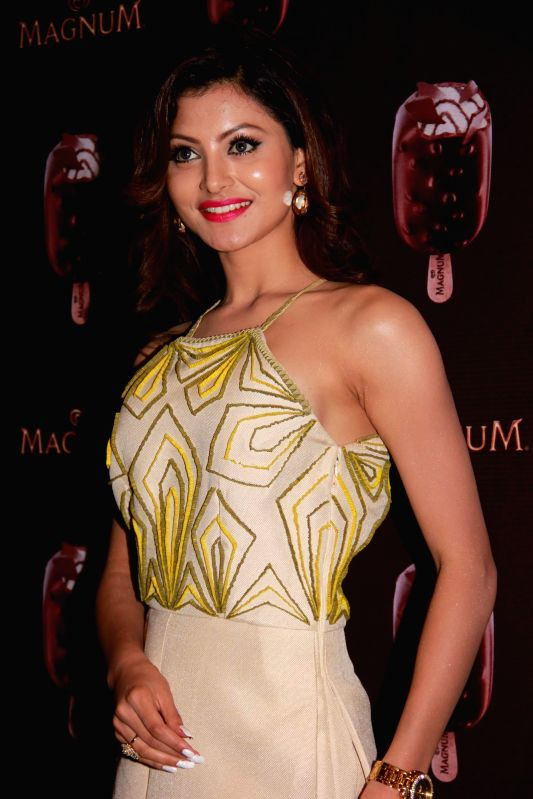 Actor Urvashi Rautela during the launch of a new Choco Cappuccino flavour of HUL`s Magnum Icecream in Mumbai on Feb 22, 2015. - Urvashi Rautela