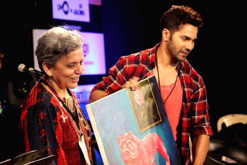 Actor Varun Dhavan and Artist Brinda Miller during the closing ceremony of Kala Ghoda festival in Mumbai on Feb 15, 2015. - Varun Dhavan