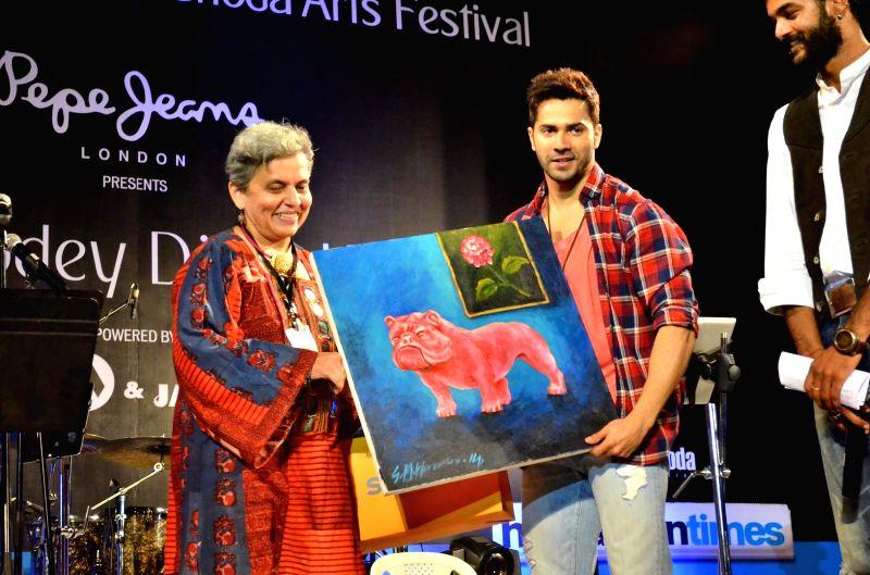 Actor Varun Dhavan and Artist Brinda Miller during the closing ceremony of Kala Ghoda festival in Mumbai on Feb 15, 2015. - Varun Dhavan