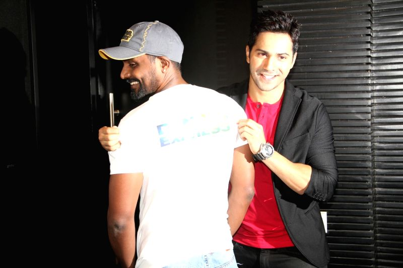 Mumbai: Actor Varun Dhawan and choreographer  Remo D'Souza during the launch of the song 'Chunar' of the film ABCD 2 in Mumbai, on June 8, 2015.