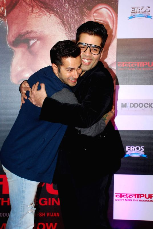 Actor Varun Dhawan and filmmaker Karan Johar during the success party of the film Badlapur in Mumbai on Feb 27, 2015. - Varun Dhawan and Karan Johar