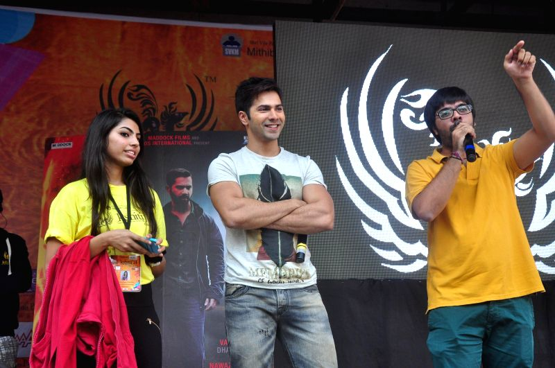 Actor Varun Dhawan and music director Jigar during the promotion of upcoming film Badlapur at a college in Mumbai, on Dec 3, 2014.
