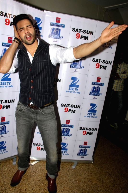 Actor Varun Dhawan during the promotion of film Badlapur on the sets of Zee TV reality show Sa Re Ga Ma Pa Li`l Champs, in Mumbai on Jan. 3, 2015. - Varun Dhawan
