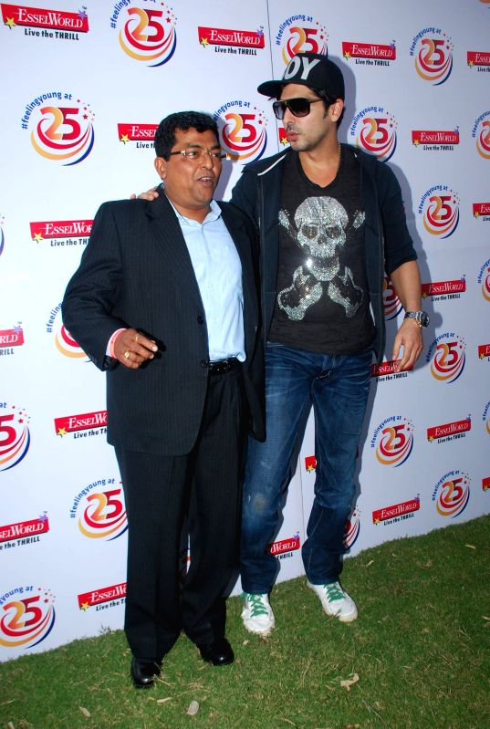 Actor Zayed Khan and Shrish Deshpande, CEO, Esselworld at Essel World`s silver jubilee celebration in Mumbai, on Dec. 24, 2014.