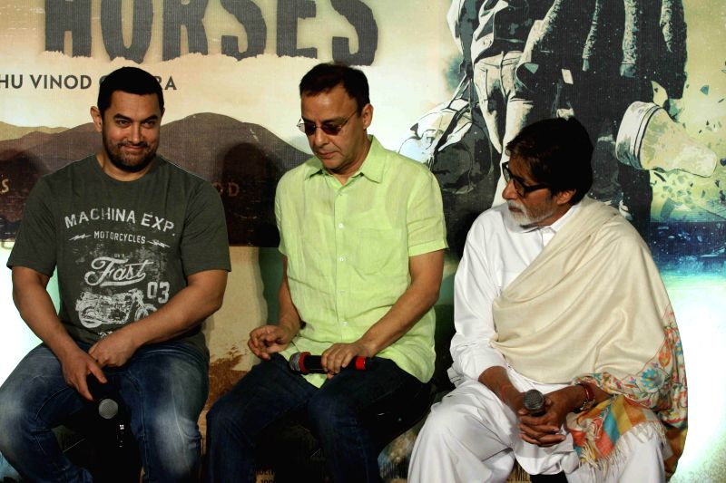 Actors Aamir Khan and Amitabh Bachchan during the trailer launch of filmmaker Vidhu Vinod Chopra's maiden Hollywood venture Broken Horses at PVR Cinemas in Mumbai  on March 10, 2015. - Aamir Khan, Amitabh Bachchan and Vidhu Vinod Chopra