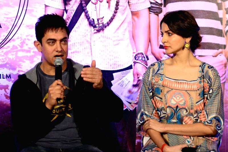 Actors Aamir Khan and Anushka Sharma during the promotion of the film PK in Hyedrabad. - Anushka Sharma