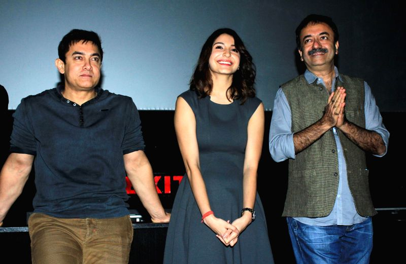 Actors Aamir Khan, Anushka Sharma and filmmaker Rajkumar Hirani during special screening of film PK organised for the Mumbai Police officials in Mumbai on Dec 18, 2014. - Aamir Khan and Anushka Sharma