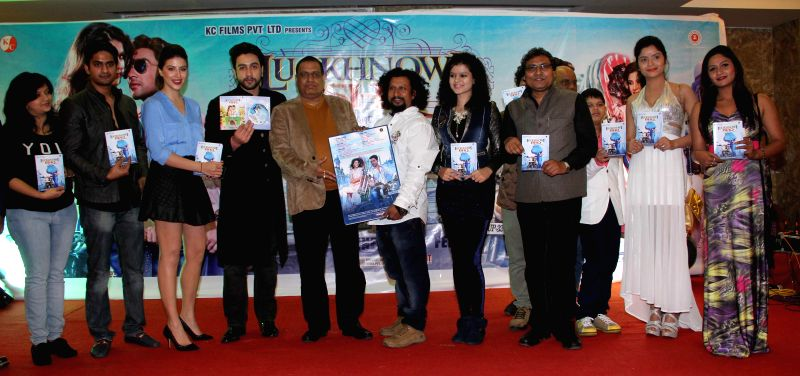 Actors Adhyayan Suman, Karishma Kotak, filmmaker Vijay K Mishra and Anand Raut during the first look on film Luckhnowi Ishq in Mumbai on Tuesday, Jan 27, 2015. - Adhyayan Suman, Karishma Kotak and Vijay K Mishra