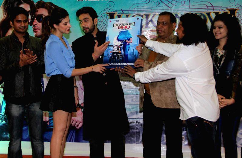 Actors Adhyayan Suman, Karishma Kotak, filmmaker Vijay K Mishra and Anand Raut during the first look on film Luckhnowi Ishq in Mumbai on Tuesday, Jan 27, 2015. - Adhyayan Suman, Karishma Kotak and Vijay K Mishra