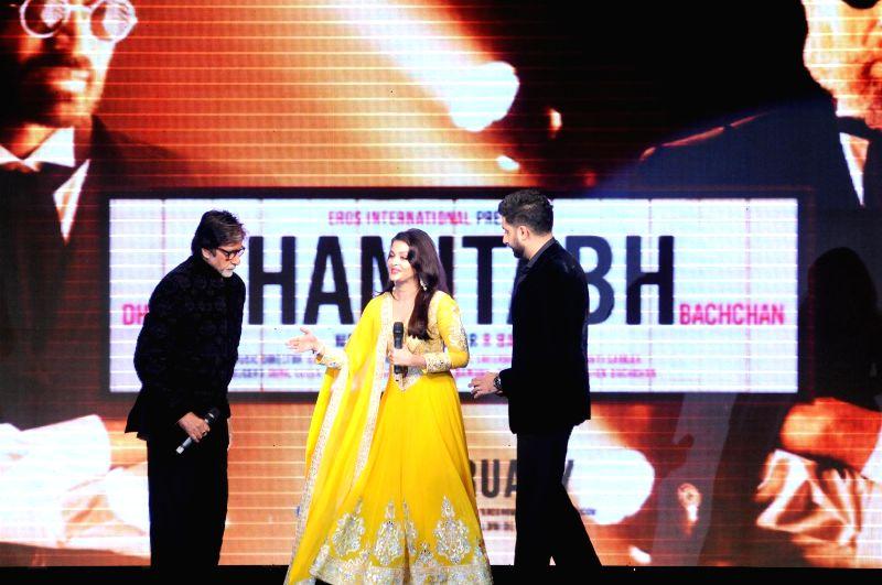 Actors Amitabh Bachchan, Abhishek Bachchan and Aishwarya Rai Bachchan during the trailer launch of upcoming film Shamitabh and celebration of 1000 film of music composer Ilaiyaraaja in Mumbai - Amitabh Bachchan, Abhishek Bachchan and Aishwarya Rai Bachchan