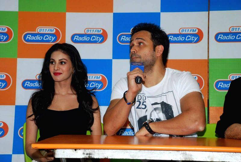 Actors Amyra Dastur and Emran Hashmi during the music launch of film Mr. X at Radio City in Mumbai, on March 13, 2015. - Amyra Dastur and Emran Hashmi