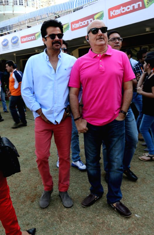Actors Anil Kapoor and Anupam Kher during the Celebrity Cricket League (CCL) in Mumbai, on jan. 10, 2015. - Anil Kapoor and Anupam Kher