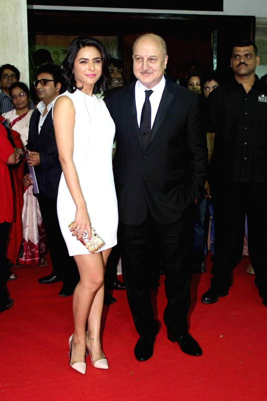 Actors Anupam Kher and Madhurima Tuli during the premiere of film Baby in Mumbai, on Jan. 23, 2015. - Anupam Kher and Madhurima Tuli