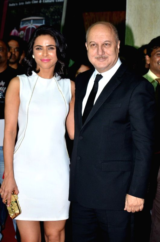 Actors Anupam Kher and Madhurima Tuli during the premiere of film Baby in Mumbai, on Jan 23, 2015. - Anupam Kher and Madhurima Tuli