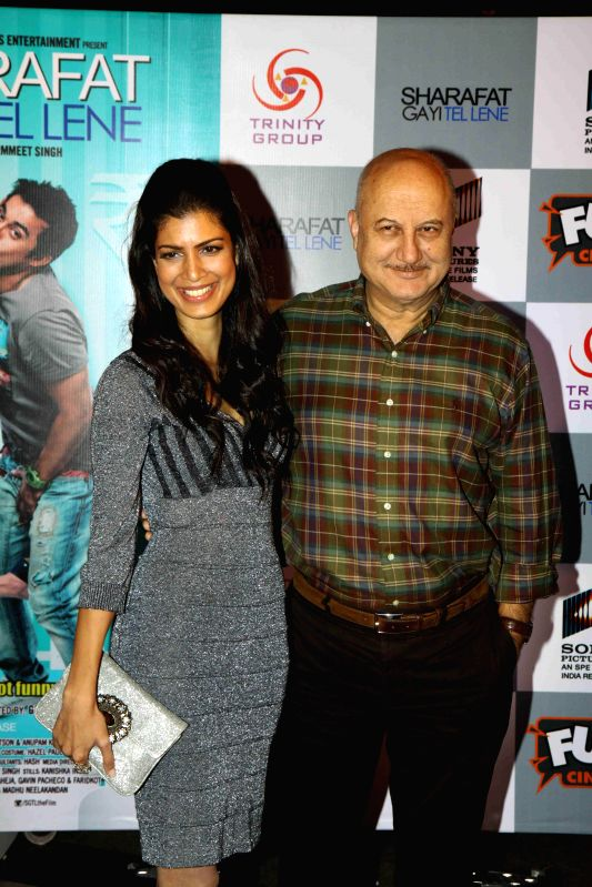 "Actors Anupam Kher and Tina Desai during the premiere of film ""Sharafat Gayi Tel Lene"" in Mumbai, on Jan. 15, 2015. - Anupam Kher and Tina Desai"