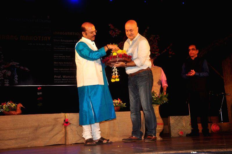 Actors Anupam Kher and Waman Kendre, Director, NSD, during the inauguration of National Tribal Festival Adi Rang Mahotsav in Mumbai, on Dec. 12, 2014. - Waman Kendre
