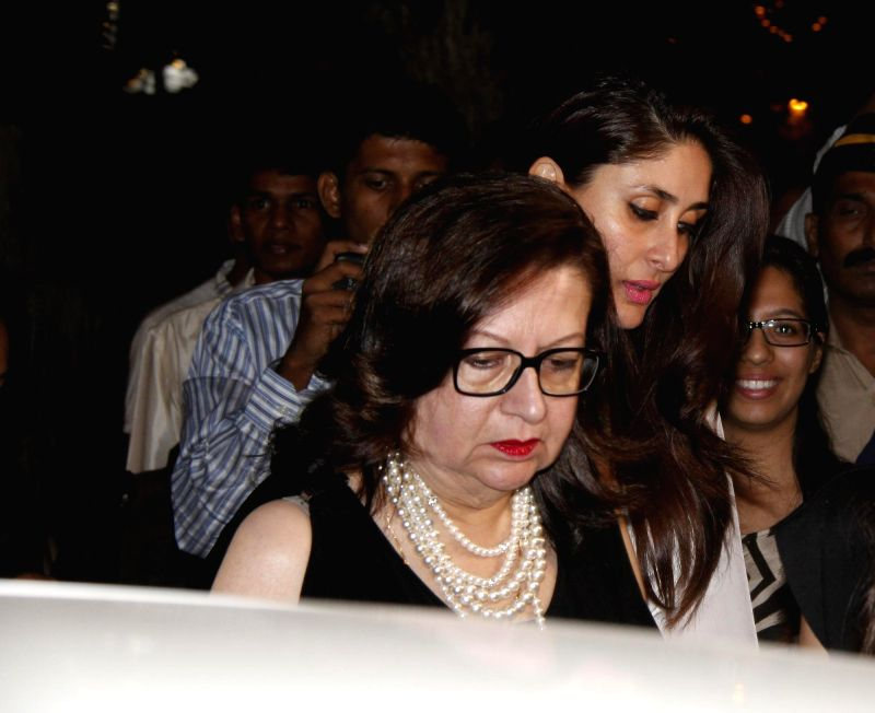 Actors Babita and Kareena Kapoor Khan attend the Midnight Mass on Christmas Eve at a Church in Mumbai, on Dec 24, 2014. - Babita and Kareena Kapoor Khan