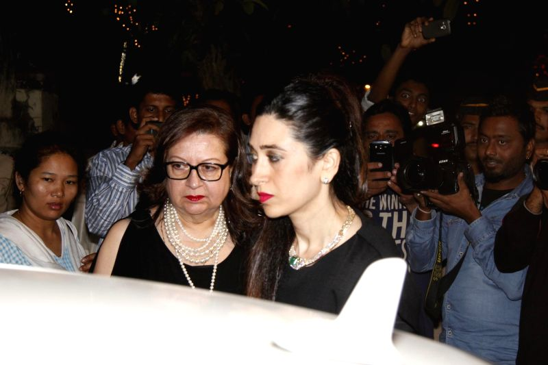 Actors Babita and Karishma Kapoor attend the Midnight Mass on Christmas Eve at a Church in Mumbai, on Dec 24, 2014. - Babita and Karishma Kapoor