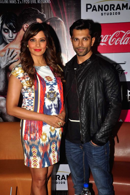 Actors Bipasha Basu and Karan Singh Grover during the promotion of film Alone in Mumbai, on jan. 09, 2015. - Bipasha Basu and Karan Singh Grover