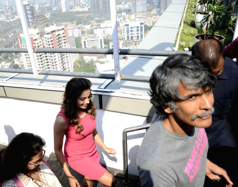 Actors Bipasha Basu and Milind Soman at a press conference regarding Pinkathon in Mumbai on Nov 25, 2014. The third edition of the marathon is scheduled on 14 December 2014. - Bipasha Basu and Milind Soman