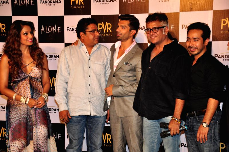 Actors Bipasha Basu, Karan Singh Grover and filmmaker Bhushan Patel during the trailer launch of film Alone in Mumbai, on Dec. 9, 2014. - Bipasha Basu, Karan Singh Grover and Bhushan Patel