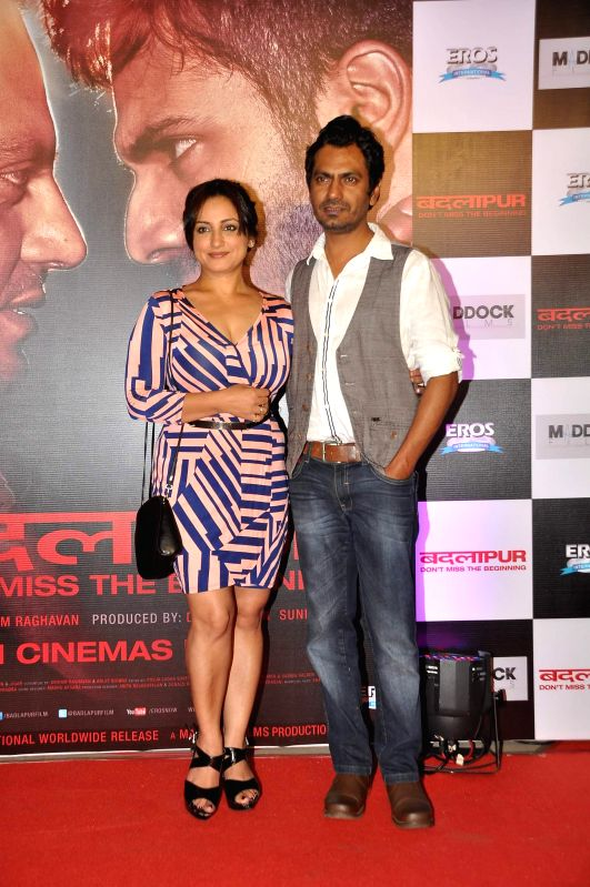 Actors Divya Dutta and Nawazuddin Siddiqui during the success party of the film Badlapur in Mumbai on Feb 27, 2015. - Divya Dutta and Nawazuddin Siddiqui