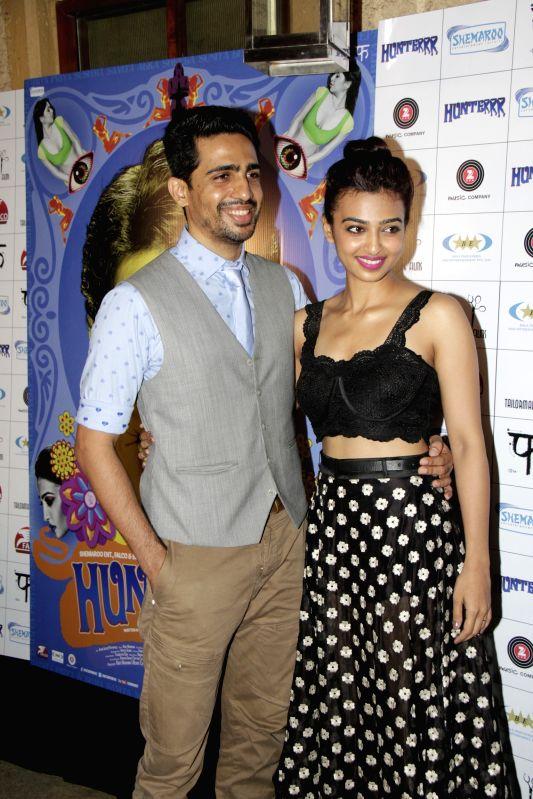 Actors Gulshan Devaiya and Radhika Apte during the success party of film Hunterrr in Mumbai on March 27, 2015. - Gulshan Devaiya and Radhika Apte